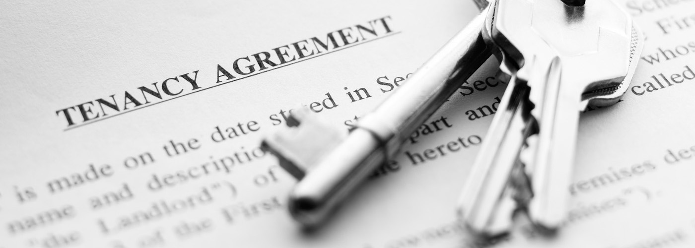 Photograph of keys and tenancy agreement